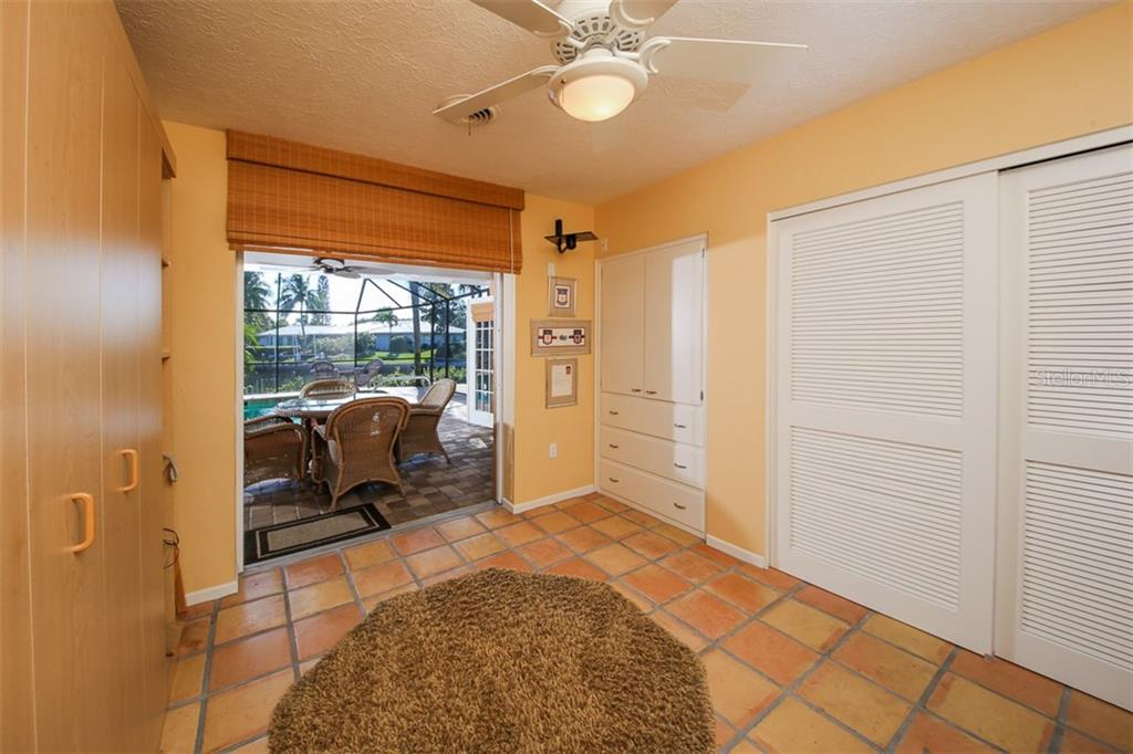 3rd bedroom with abundant storage and builit in cabinetry. - Single Family Home for sale at 5281 Cape Leyte Way, Sarasota, FL 34242 - MLS Number is A4171478