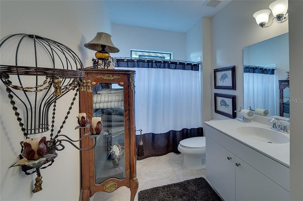 Bathroom 2.  Located conveniently between second and third bedrooms - Single Family Home for sale at 7254 Lake Forest Gln, Lakewood Ranch, FL 34202 - MLS Number is A4174107