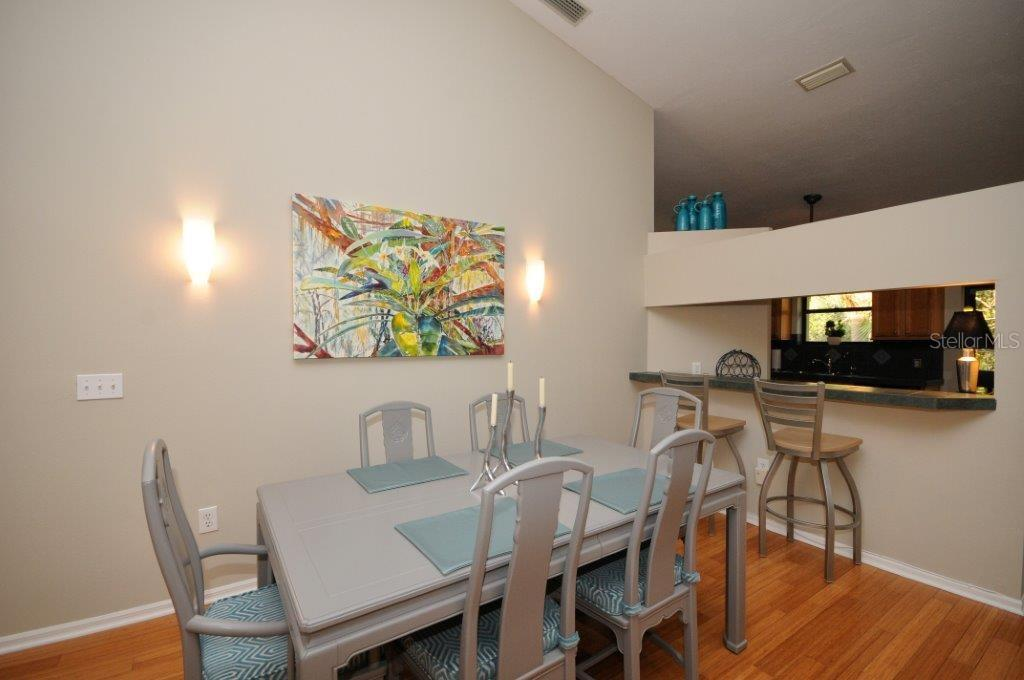 Dining area - Condo for sale at Address Withheld, Sarasota, FL 34231 - MLS Number is A4175607