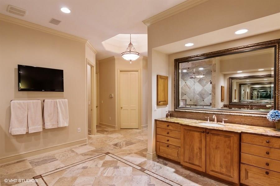 Spacious Master Bath - Custom Designed Walk In Closets as well. - Single Family Home for sale at 8130 Perry Maxwell Cir, Sarasota, FL 34240 - MLS Number is A4175735