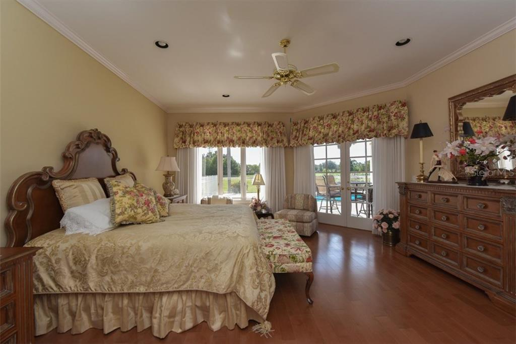 Master Bedroom on 1st level - Single Family Home for sale at 4298 Boca Pointe Dr, Sarasota, FL 34238 - MLS Number is A4176372