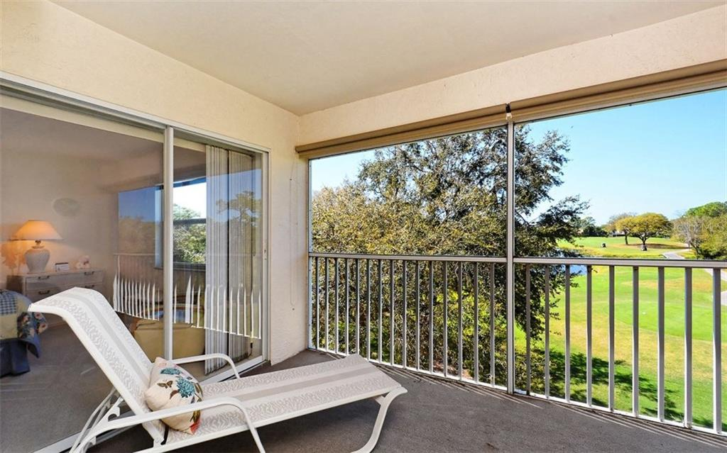 Well placed tress afford sunset shade without diminishing the sweeping views. - Condo for sale at 8750 Olde Hickory Ave #9305, Sarasota, FL 34238 - MLS Number is A4178271