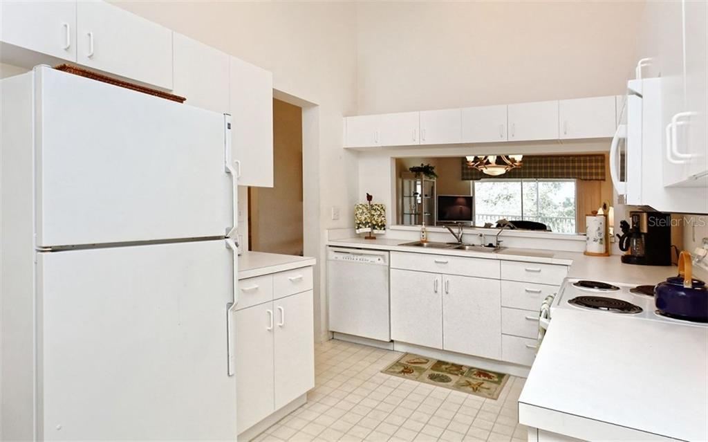 Spacious kitchen has a separate eating area. - Condo for sale at 8750 Olde Hickory Ave #9305, Sarasota, FL 34238 - MLS Number is A4178271