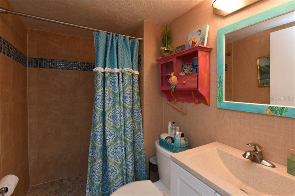 New ceramic tile throughout the master bath, new vanity and all plumbing. - Condo for sale at 1330 Glen Oaks Dr E #275d, Sarasota, FL 34232 - MLS Number is A4178649