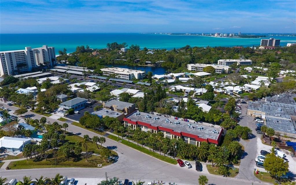 Aerial view of building and looking northwest over Gulf of Mexico - Condo for sale at 133 Avenida Messina #4, Sarasota, FL 34242 - MLS Number is A4179566