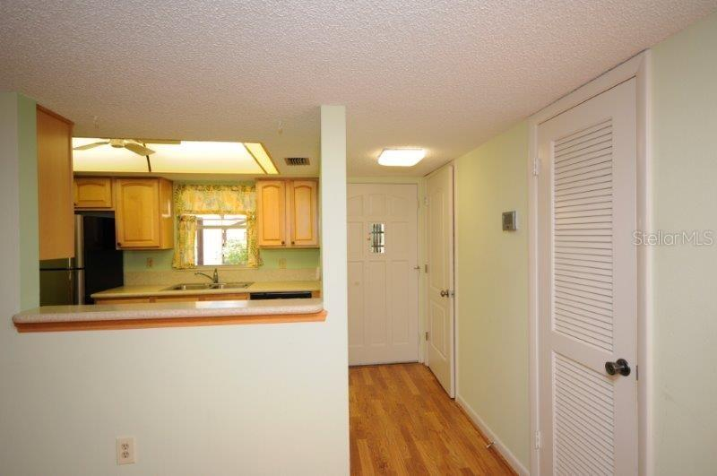 Kitchen and Foyer - Condo for sale at 2215 Circlewood Dr #46, Sarasota, FL 34231 - MLS Number is A4180138