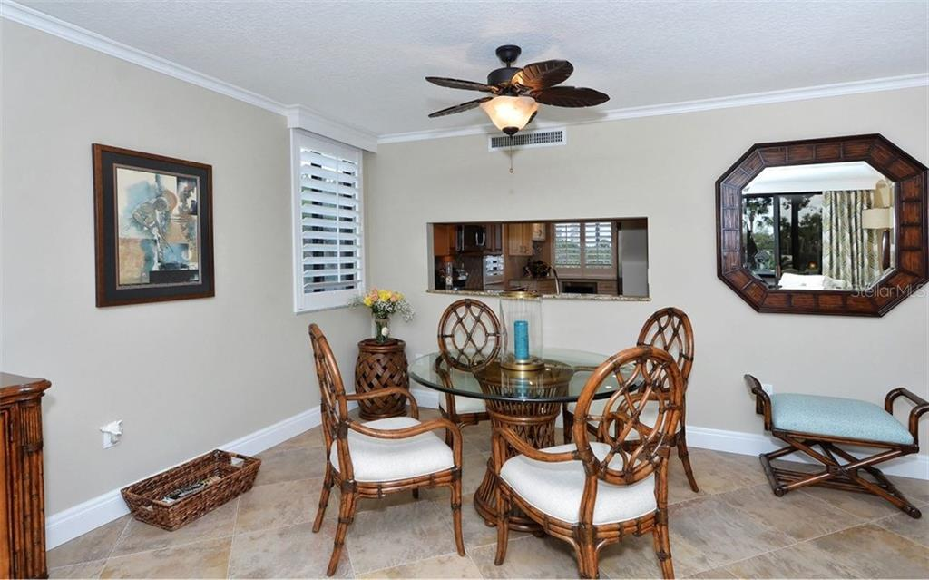Dining area with pass-thru from kitchen - Condo for sale at 6263 Midnight Pass Rd #101, Sarasota, FL 34242 - MLS Number is A4182245