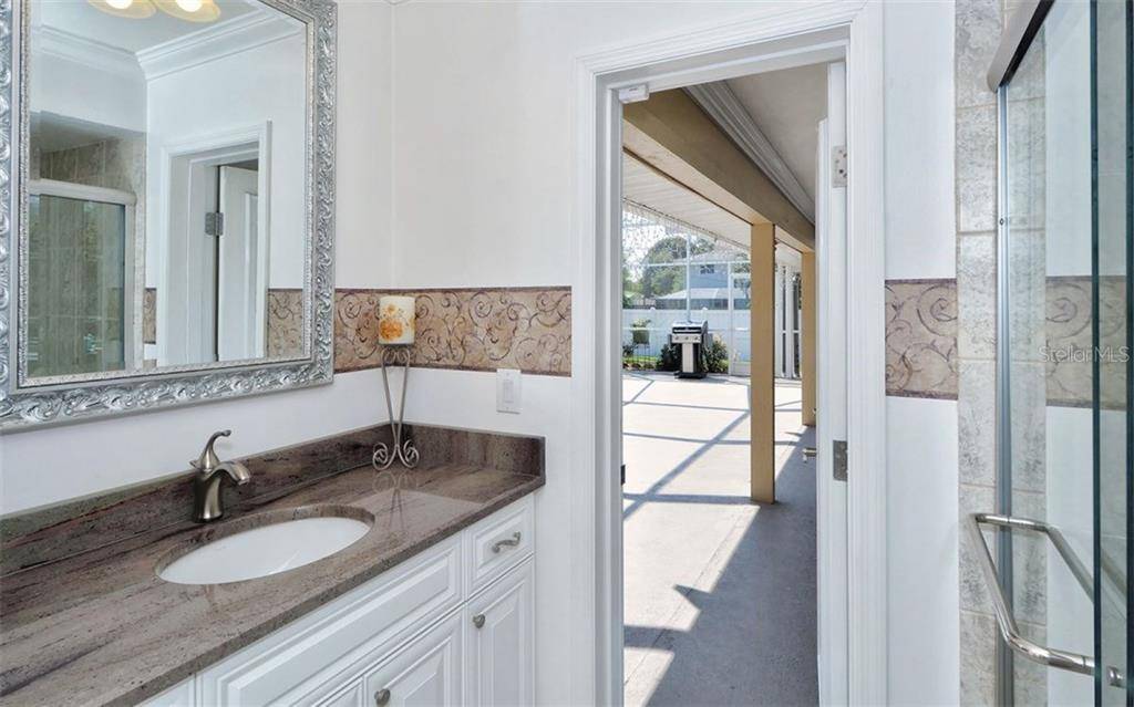 Third bath services the pool. Beautiful counters & cabinets, stylish décor. - Single Family Home for sale at 6239 Hollywood Blvd, Sarasota, FL 34231 - MLS Number is A4182790