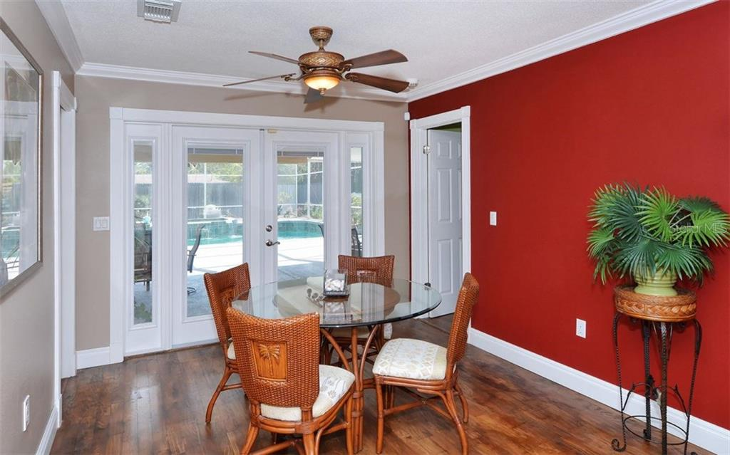 The dining room can fit a large table. - Single Family Home for sale at 6239 Hollywood Blvd, Sarasota, FL 34231 - MLS Number is A4182790