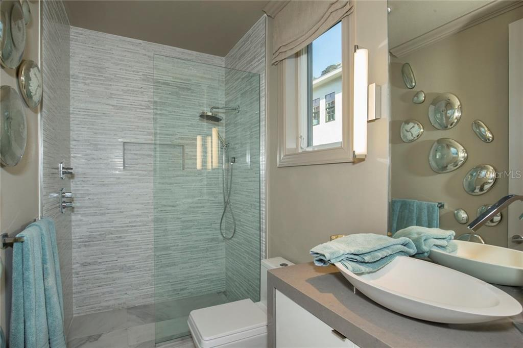 En-suite. - Single Family Home for sale at 8319 Midnight Pass Rd, Sarasota, FL 34242 - MLS Number is A4184004