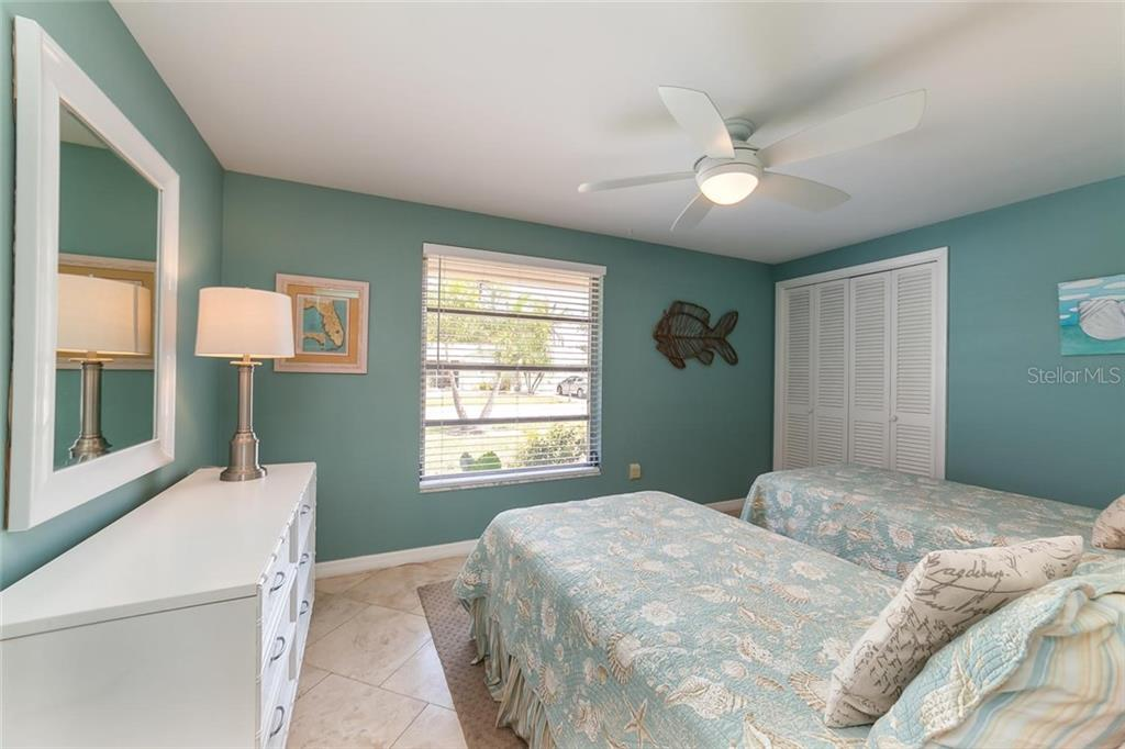 The huge 3rd bedroom offers plenty of space for visiting guests. - Single Family Home for sale at 413 Bay Palms Dr, Holmes Beach, FL 34217 - MLS Number is A4184679