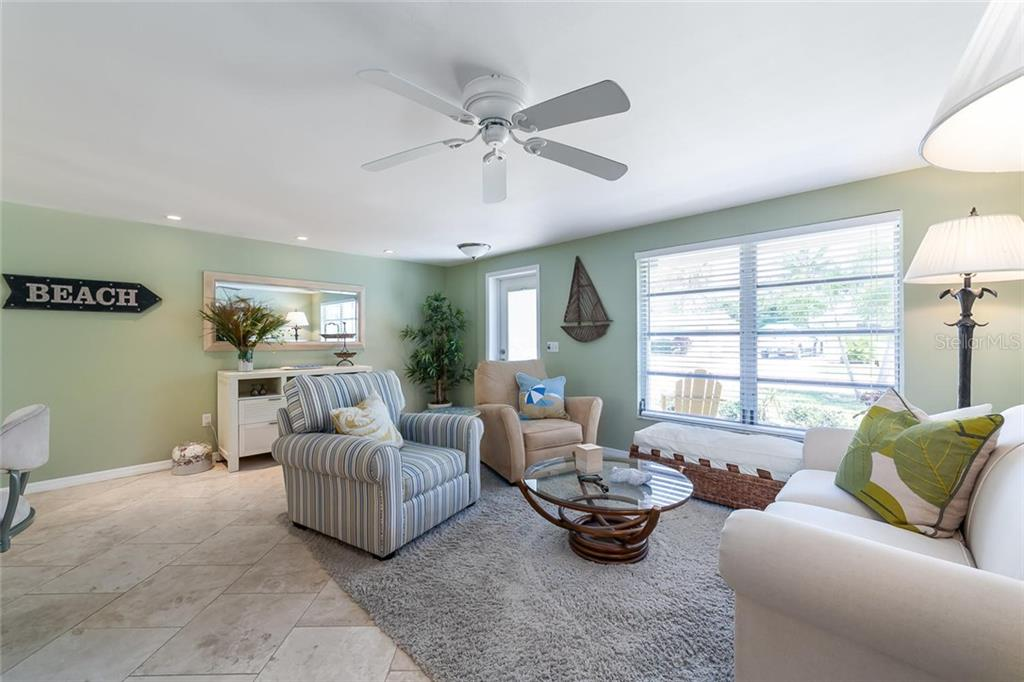 The open floor plan creates a light and bright living room. - Single Family Home for sale at 413 Bay Palms Dr, Holmes Beach, FL 34217 - MLS Number is A4184679