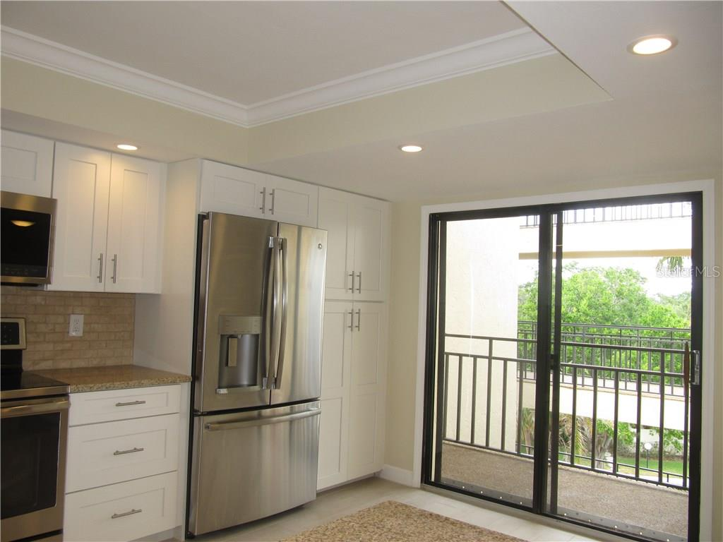 Kitchen opens to rear balcony - Condo for sale at 6440 Mourning Dove Dr #404, Bradenton, FL 34210 - MLS Number is A4185069