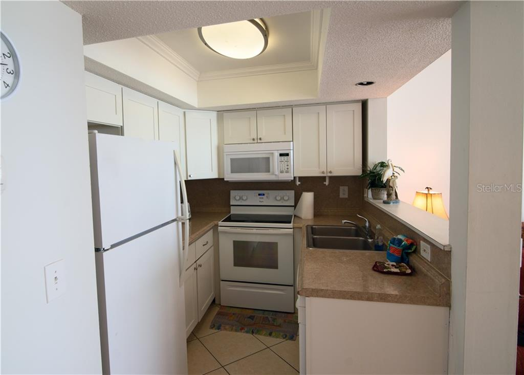 Kitchen - Condo for sale at 100 73rd St #204a, Holmes Beach, FL 34217 - MLS Number is A4185340