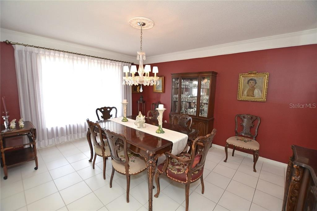 This formal dining area can seat many and offers a large window for lots of natural light. - Single Family Home for sale at 1157 Wyeth Dr, Nokomis, FL 34275 - MLS Number is A4185839