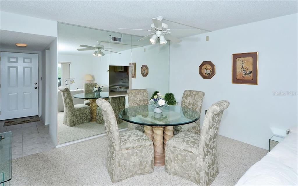 Dining area - Condo for sale at 9397 Midnight Pass Rd #403, Sarasota, FL 34242 - MLS Number is A4185842