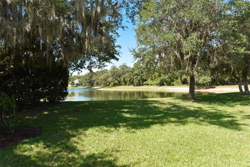 Lake view from pool with abundant deer and water birds. - Single Family Home for sale at 4851 Sweetshade Dr, Sarasota, FL 34241 - MLS Number is A4186306