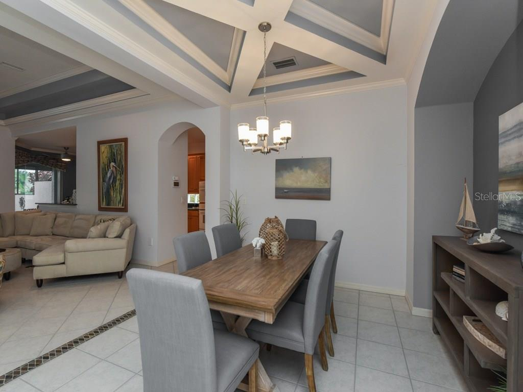 Formal dining with X tray ceiling and slate border. - Single Family Home for sale at 1307 Copperwood Dr, Osprey, FL 34229 - MLS Number is A4186695