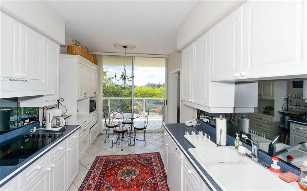 Kitchen with a view - Condo for sale at 1800 Benjamin Franklin Dr #a202, Sarasota, FL 34236 - MLS Number is A4187131