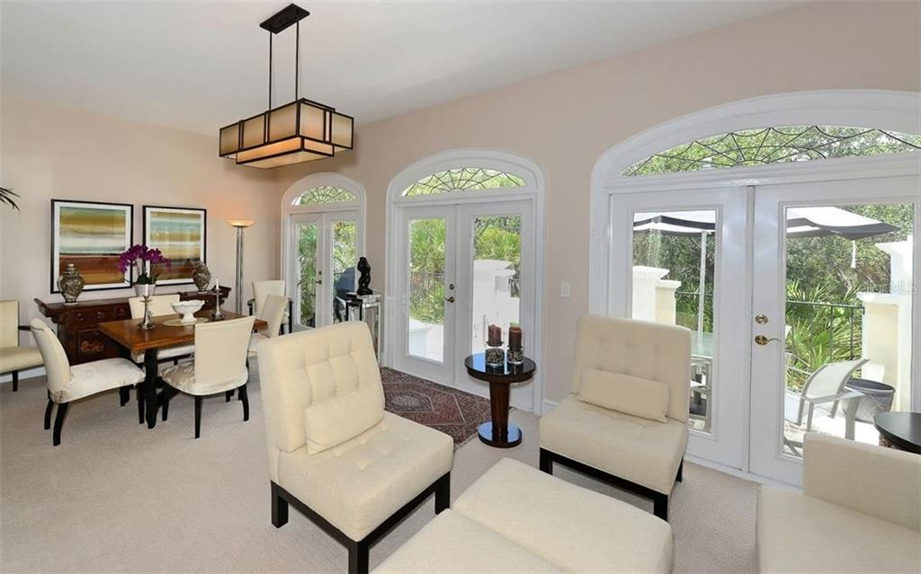 Living/Dining room - Townhouse for sale at 68 Bishops Court Rd #115, Osprey, FL 34229 - MLS Number is A4187983