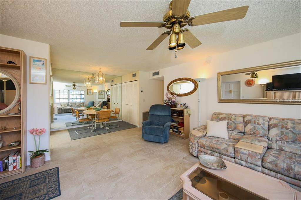 Living/Dining room - Condo for sale at 5800 Hollywood Blvd #113, Sarasota, FL 34231 - MLS Number is A4188016