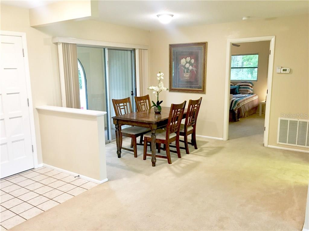 entryway and Dining room - Villa for sale at 510 Villa Park Dr #510, Nokomis, FL 34275 - MLS Number is A4188232