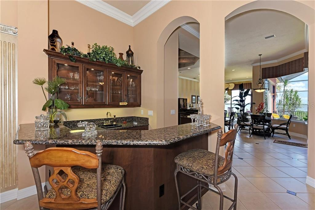 Wet Bar includes sink and wine bar/refrigerator - Single Family Home for sale at 370 Highland Shores Dr, Ellenton, FL 34222 - MLS Number is A4188456