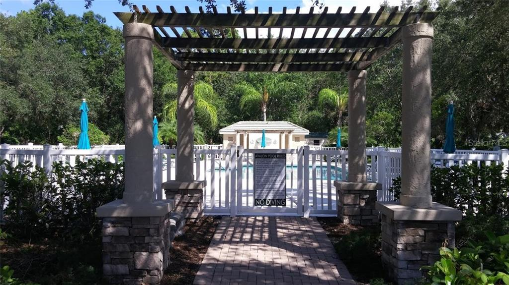 Who wouldn't love this gracious entrance to the large, sunny (and heated) community pool! - Villa for sale at 6953 Mystic Ln, Sarasota, FL 34243 - MLS Number is A4188738
