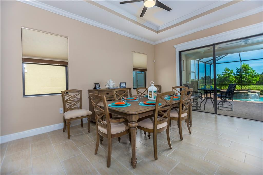 Dining area to lanai and pool - Single Family Home for sale at 23883 Waverly Cir, Venice, FL 34293 - MLS Number is A4190222