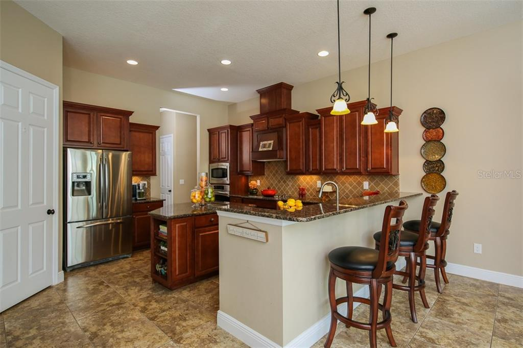 Chef's Kitchen Featuring Stainless Appliances; Large Prep Island; Walk-in Pantry & Breakfast Bar - Single Family Home for sale at 5770 Rock Dove Dr, Sarasota, FL 34241 - MLS Number is A4190439