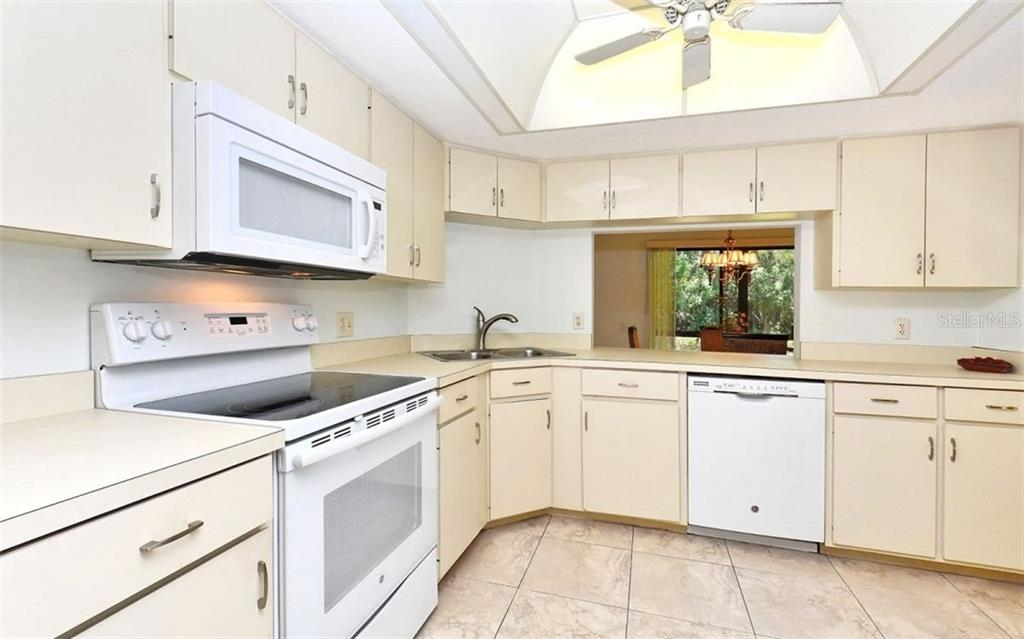 Kitchen with all newer appliances - breakfast area not shown - Condo for sale at 104 Woodland Pl #104, Osprey, FL 34229 - MLS Number is A4190676