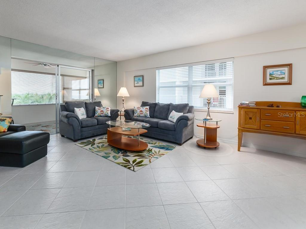 Liv Rm & Enclosed Lanai with City View - Condo for sale at 1750 Benjamin Franklin Dr #5g, Sarasota, FL 34236 - MLS Number is A4192160