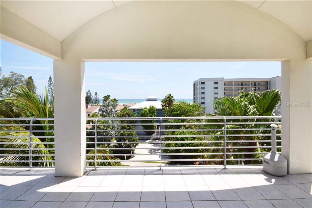 Covered balcony- great for entertaining, relaxing, storm watching, coffee and wine drinking! - Condo for sale at 439 Beach Rd #e, Sarasota, FL 34242 - MLS Number is A4192797