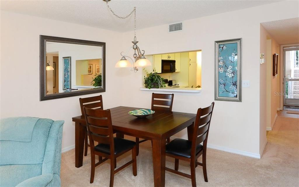 Dining area. - Condo for sale at 9300 Clubside Cir #1201, Sarasota, FL 34238 - MLS Number is A4192821