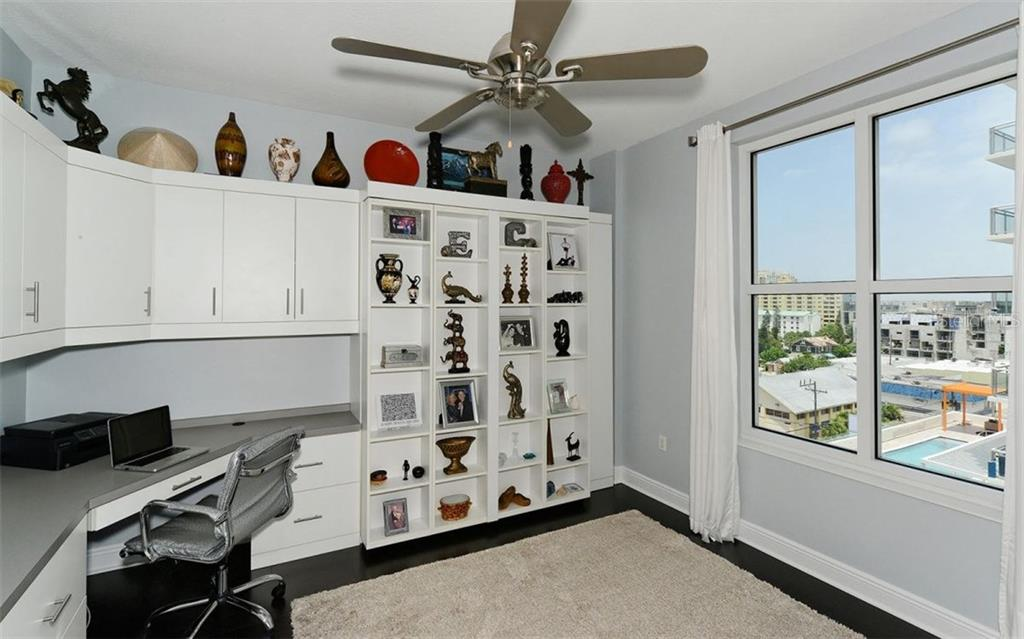 2ND BEDROOM USED AS AN OFFICE: BEHIND SHELVES THERE IS A QUEEN SIZE Murphy bed. - Condo for sale at 100 Central Ave #h716, Sarasota, FL 34236 - MLS Number is A4193586