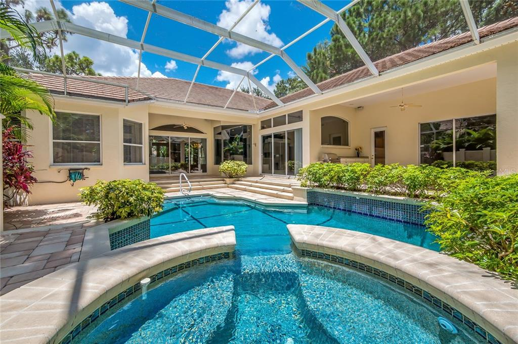 Salt water pool and spa.  Pavers throughout the lanai and two covered areas for entertaining. - Single Family Home for sale at 8019 Collingwood Ct, University Park, FL 34201 - MLS Number is A4193802