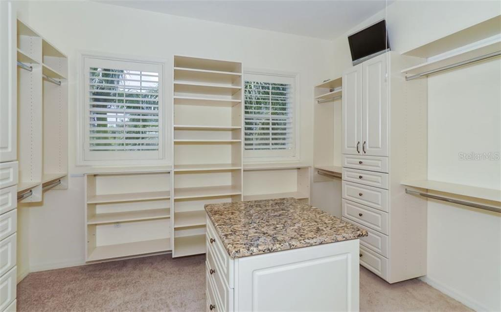 Large walk-in closet with island off of master bedroom - Single Family Home for sale at 9818 9th Ave Nw, Bradenton, FL 34209 - MLS Number is A4194125