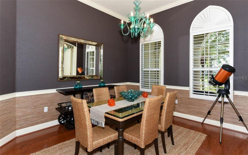 Dining room with plantation shutters. - Single Family Home for sale at 9923 Portside Ter, Bradenton, FL 34212 - MLS Number is A4195029
