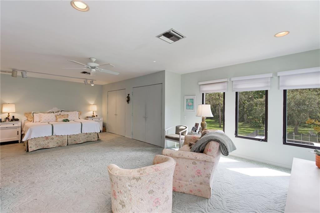 Spacious Master bedroom with access to an amazing 40' terrace overlooking the yard and swimming pool. - Single Family Home for sale at 4831 Hoyer Dr, Sarasota, FL 34241 - MLS Number is A4195351