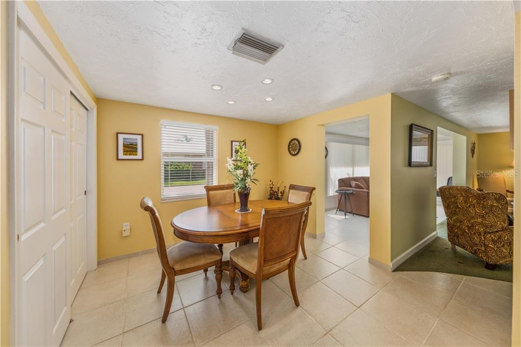 Dining area - Condo for sale at 6140 Midnight Pass Rd #c-9, Sarasota, FL 34242 - MLS Number is A4195879