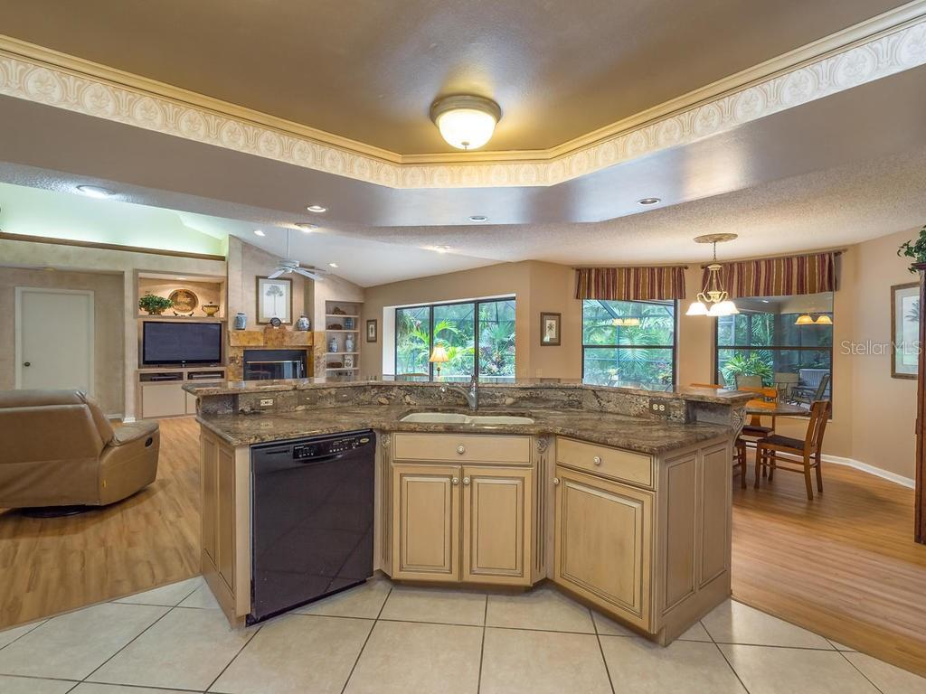 Kitchen overlooking dinette and family room - Single Family Home for sale at 7520 Weeping Willow Dr, Sarasota, FL 34241 - MLS Number is A4196497