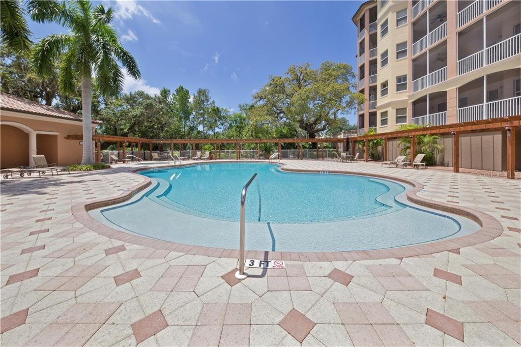 Community Pool - Condo for sale at 5531 Cannes Cir #306, Sarasota, FL 34231 - MLS Number is A4196722