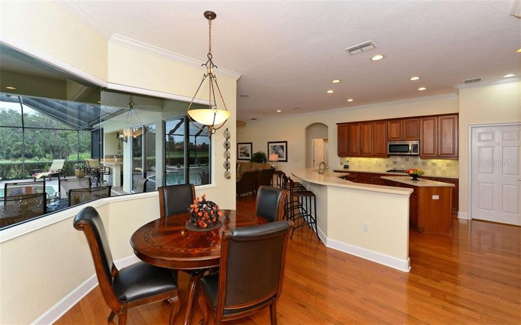 Dinette toward kitchen - Single Family Home for sale at 9919 Portside Ter, Bradenton, FL 34212 - MLS Number is A4197815