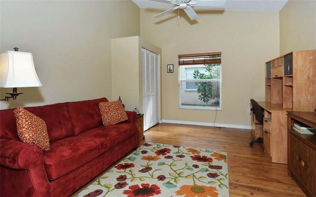 This room is either a great office/den space or a 3rd bedroom. - Single Family Home for sale at 9571 Knightsbridge Cir, Sarasota, FL 34238 - MLS Number is A4197972