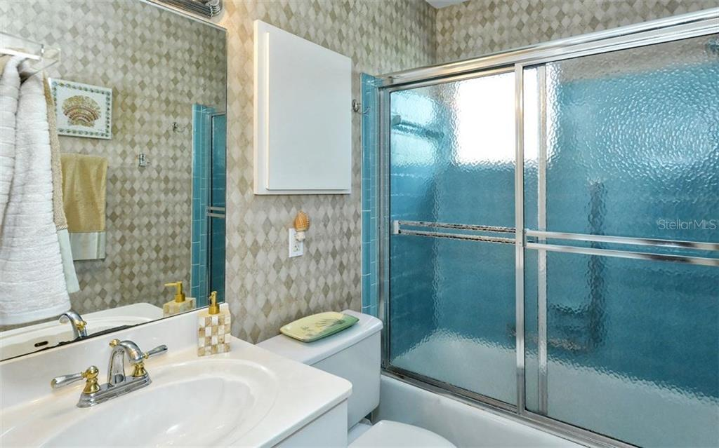 Guest bathroom - Single Family Home for sale at 6308 Midnight Pass Rd #4, Sarasota, FL 34242 - MLS Number is A4198360