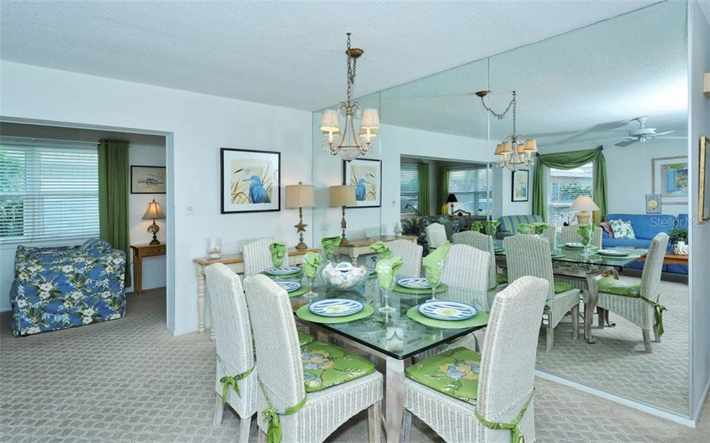 Living/Dining room - Single Family Home for sale at 6308 Midnight Pass Rd #4, Sarasota, FL 34242 - MLS Number is A4198360