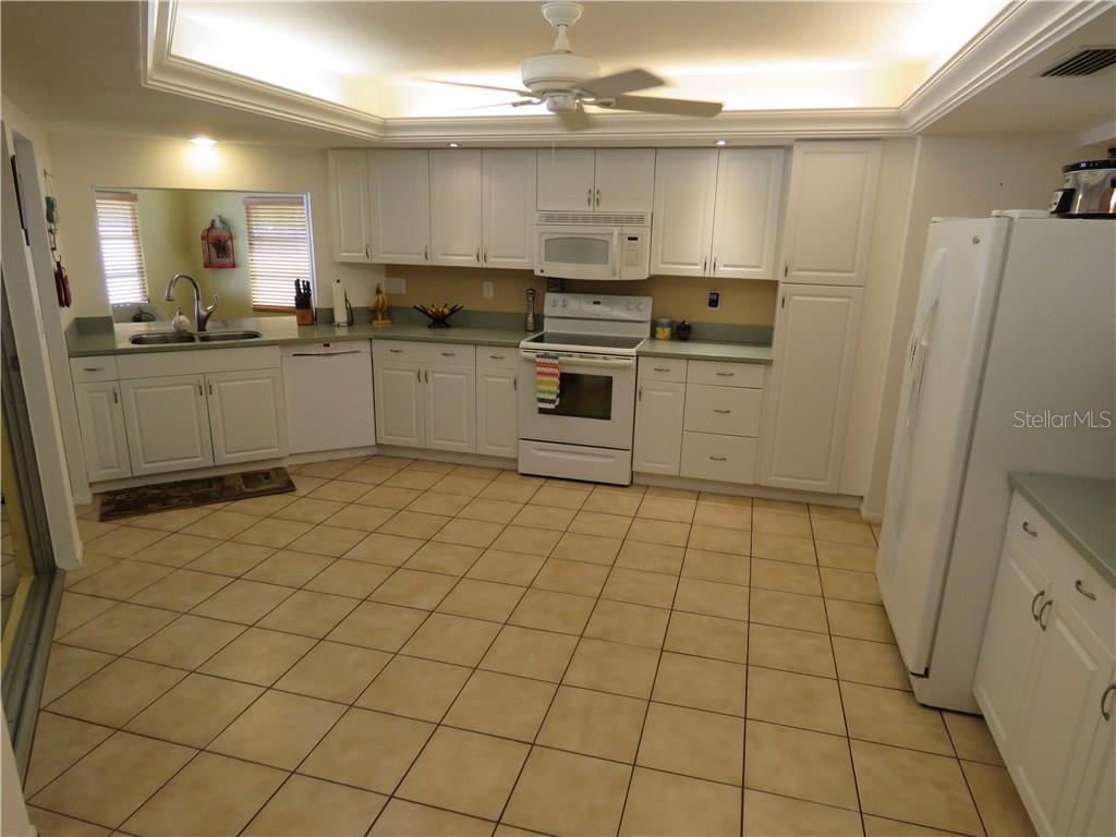 Large and bright remodeled kitchen includes solid surface counters, pantry, and lots of storage space. - Single Family Home for sale at 829 Harbor Dr S, Venice, FL 34285 - MLS Number is A4198898