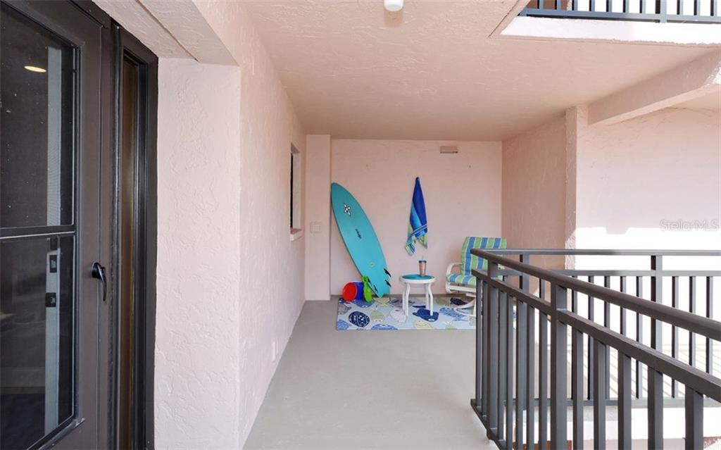 Outdoor area adjacent to front door - Condo for sale at 6480 Midnight Pass Rd #217, Sarasota, FL 34242 - MLS Number is A4202790