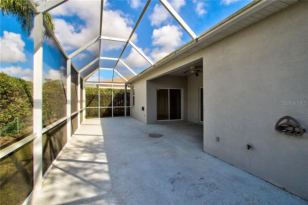 Caged, extended Lanai bordered with privacy hedge - Single Family Home for sale at 530 Hunter Ln, Bradenton, FL 34212 - MLS Number is A4203433