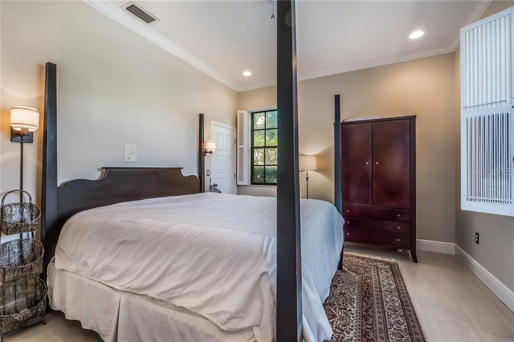 Second Bedroom with En Suite Full Bath - Single Family Home for sale at 5026 Kestral Park Way S, Sarasota, FL 34231 - MLS Number is A4203689